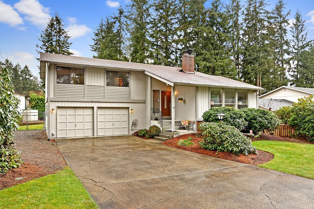 When You Arrive Home, Meticulous Landscaping, A Large Driveway, And A  Picturesque Exterior Framed By Tall Emerald Trees In The Background Welcome  You Home.