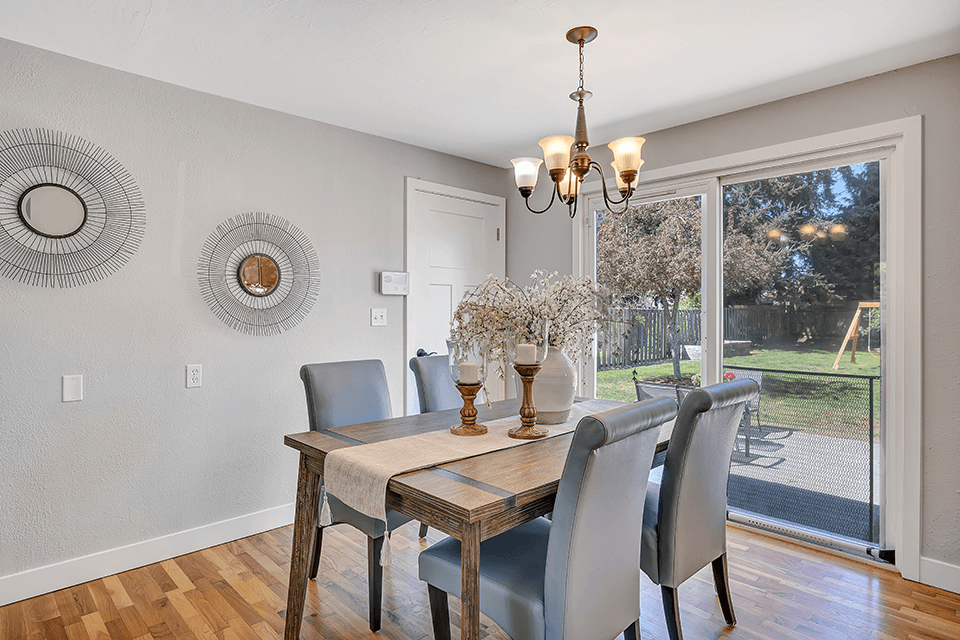 The dining room is spacious enough for large gatherings or intimate suppers and has a slider that leads out to a fully-fenced back yard oasis.