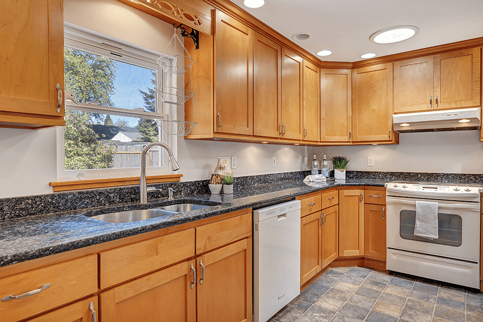 This remodeled kitchen features granite countertops, convenient pull out drawers, undercabinet lighting and solar tubes for additional natural light.