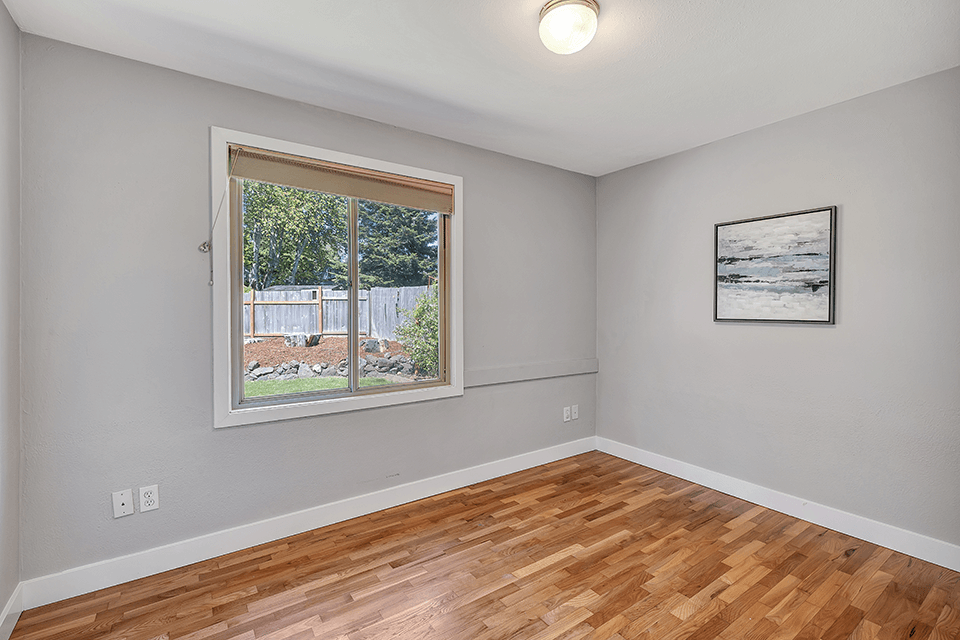 The second of two bedrooms on the main. The gleaming hardwoods continue throughout as does the fresh paint and new trim.