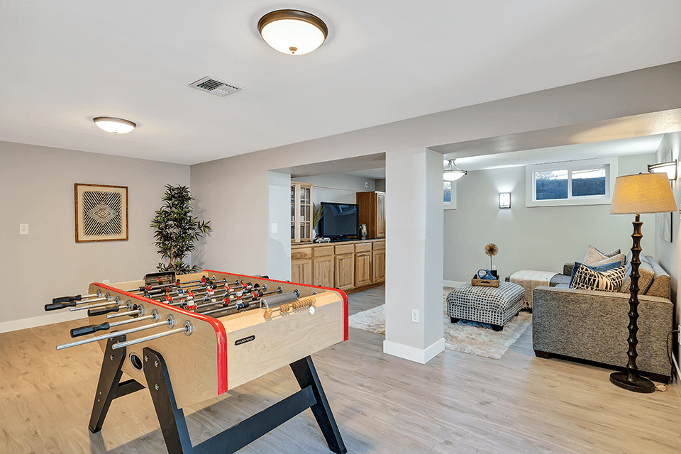 In the newly remodeled, fully finished basement, you will find lots of flexible space as well as new flooring, paint and trim.