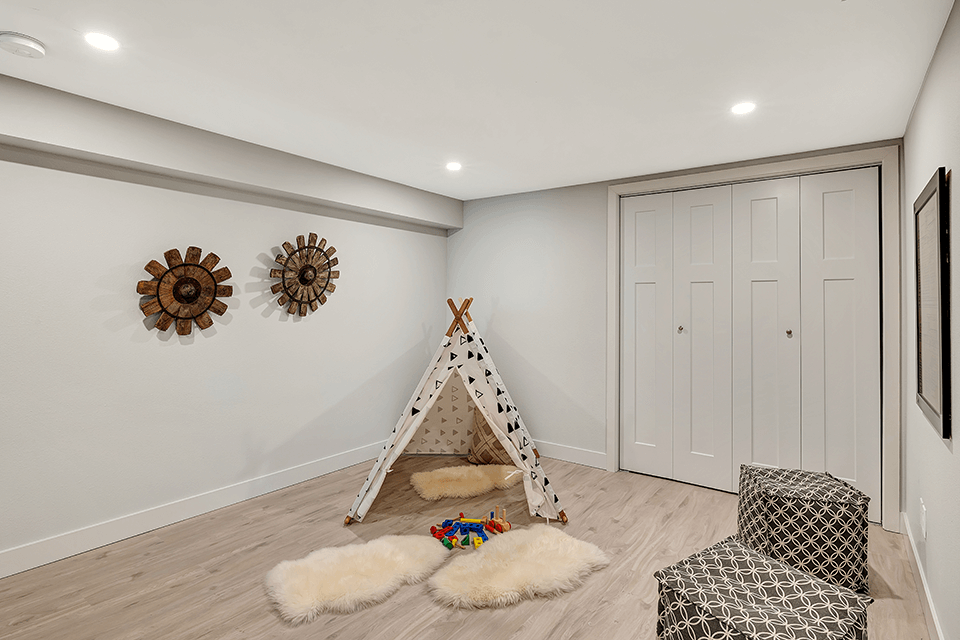 Here is another finished room, perfect for a play space. The furnace and water heater are located behind those doors.