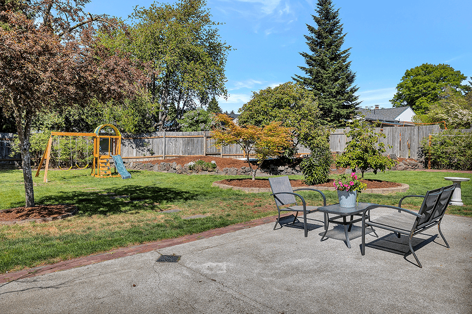 And the coup de grace of this home is the fully fenced backyard oasis!