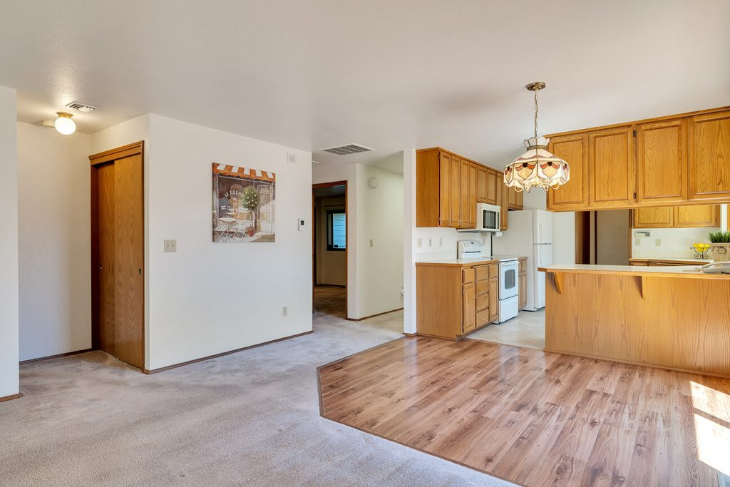 The laminate floor defines the dining space.