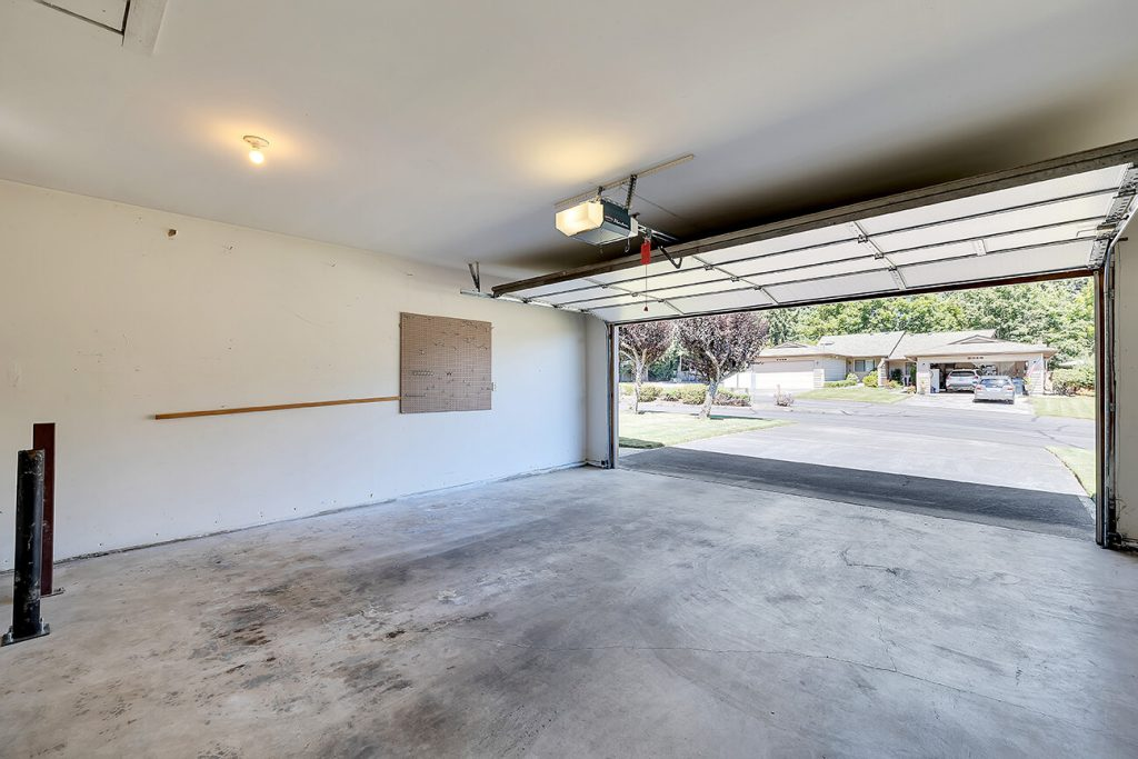 And just past the utility room is teh large 2-car garage. The driveway is flat for easy accessibility. There is also a drop down latter to access additional storage.
