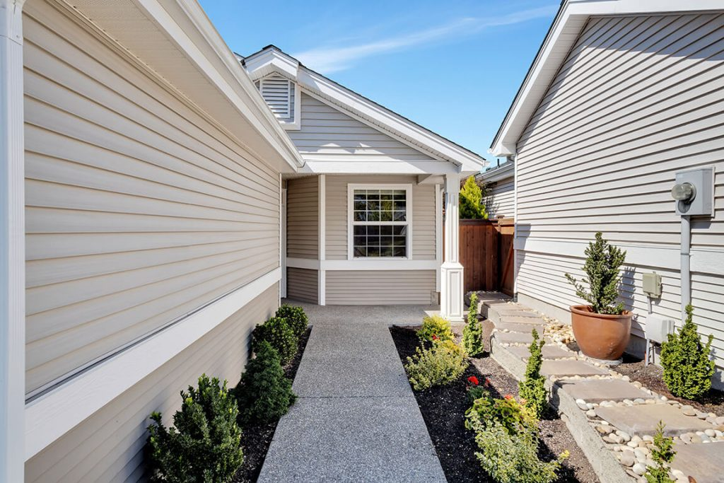 As you approach you will notice the beautiful landscaping and the immaculate condition of the exterior of these homes.