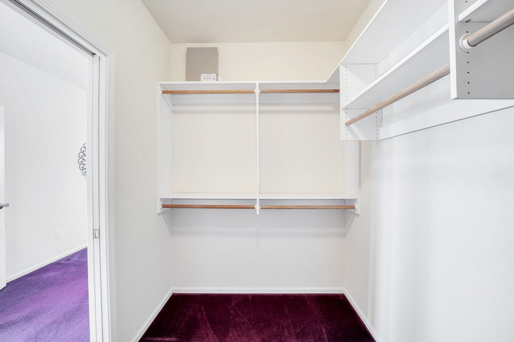 The generous-sized walk-in closet features organizers to keep everything in its place.