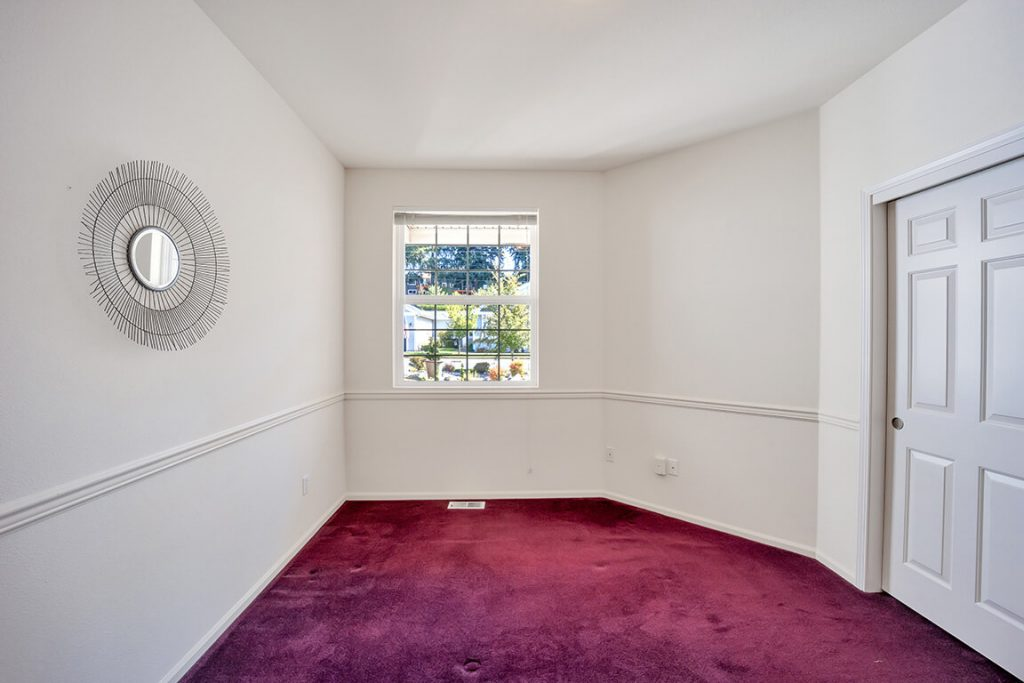 Here is the spacious guest bedroom with a large window and a large closet.