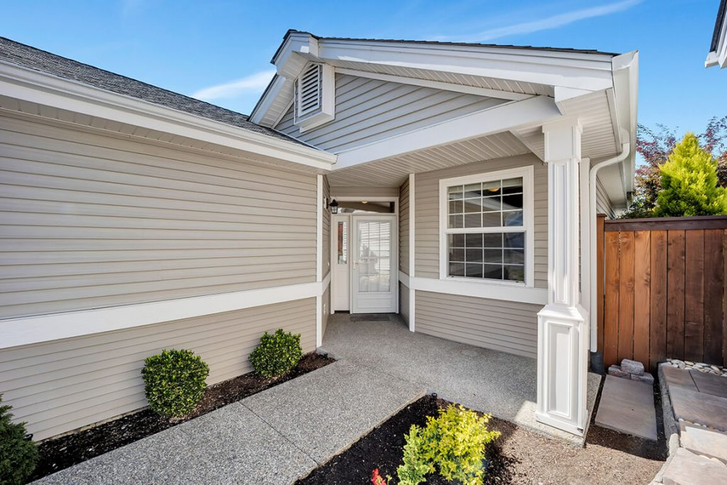 A welcoming entry with a covered porch and zero-step access.