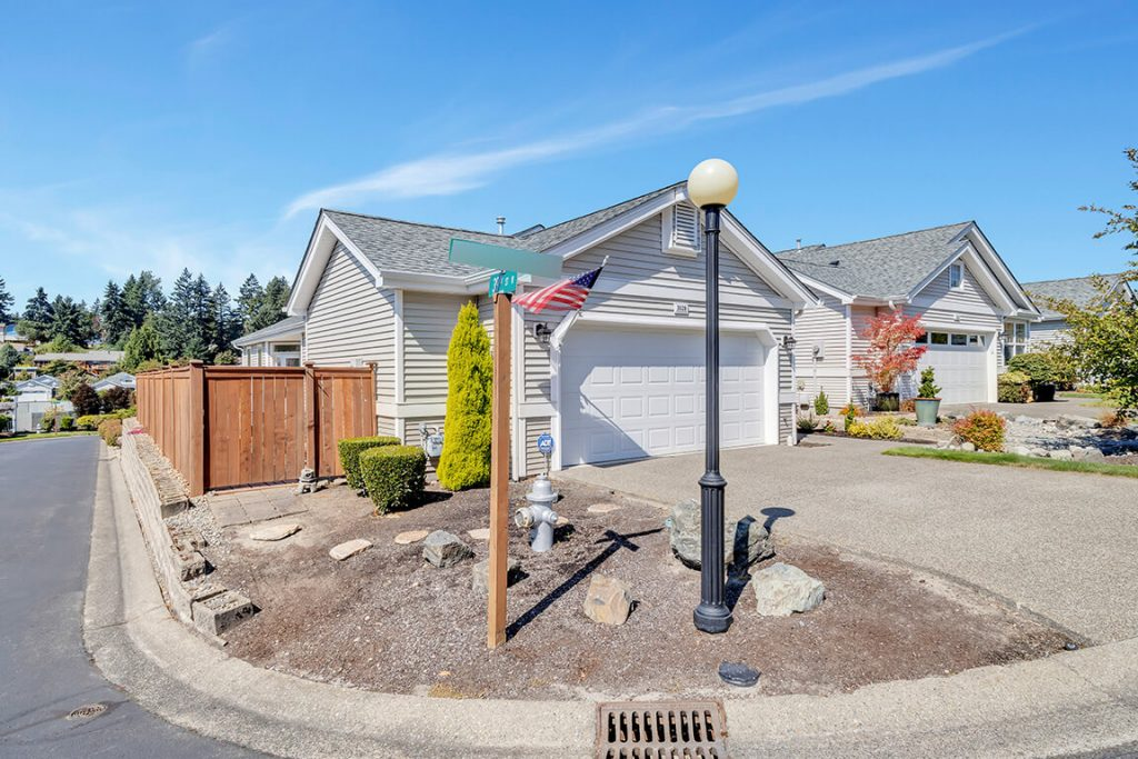 A convenient gate provides easy access to the back yard and patio.