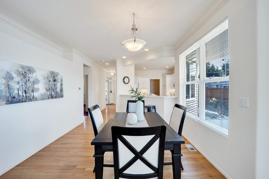 The elegant dining room is flexible enough to accommodate intimate suppers or large dinner parties and it is open to the kitchen for easy entertaining.