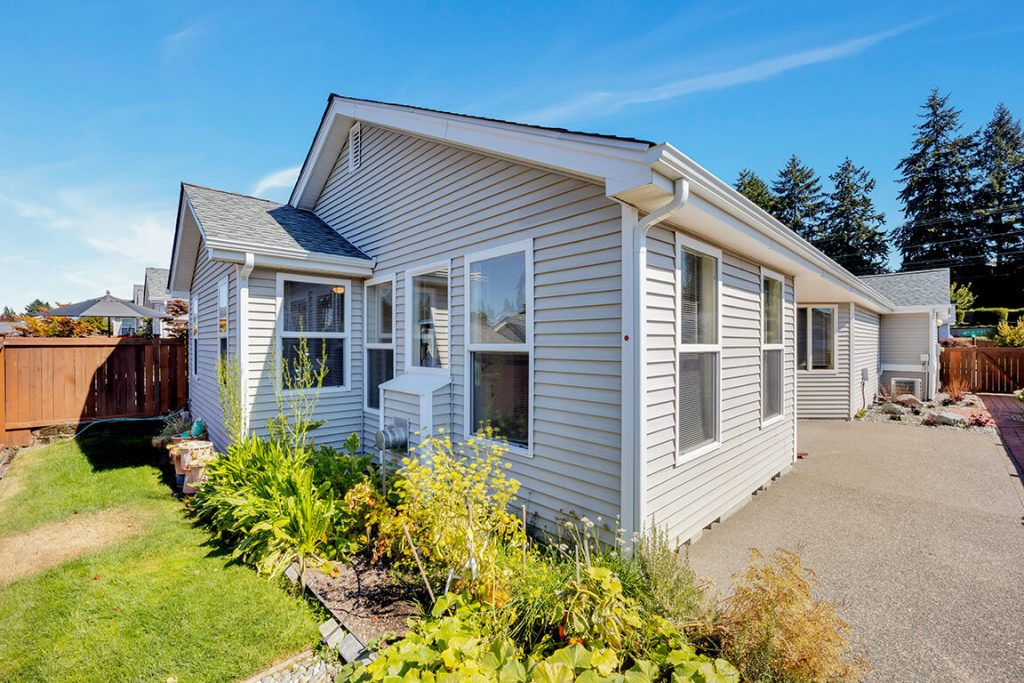 This home is situated on a sunny, fully-fenced corner lot with an extensive patio and plenty of room to garden.
